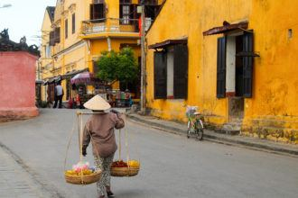 Woman carrying baskets in Hoi An, Vietnam